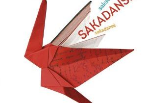 """Red origami crane, traditional Japanese art of paper folding."""